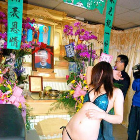 Strippers at Funeral Ceremony